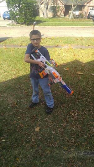 boy playing with nerf gun