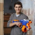 boy playing with Nerf and Strike Elite Hyperfire Blaster
