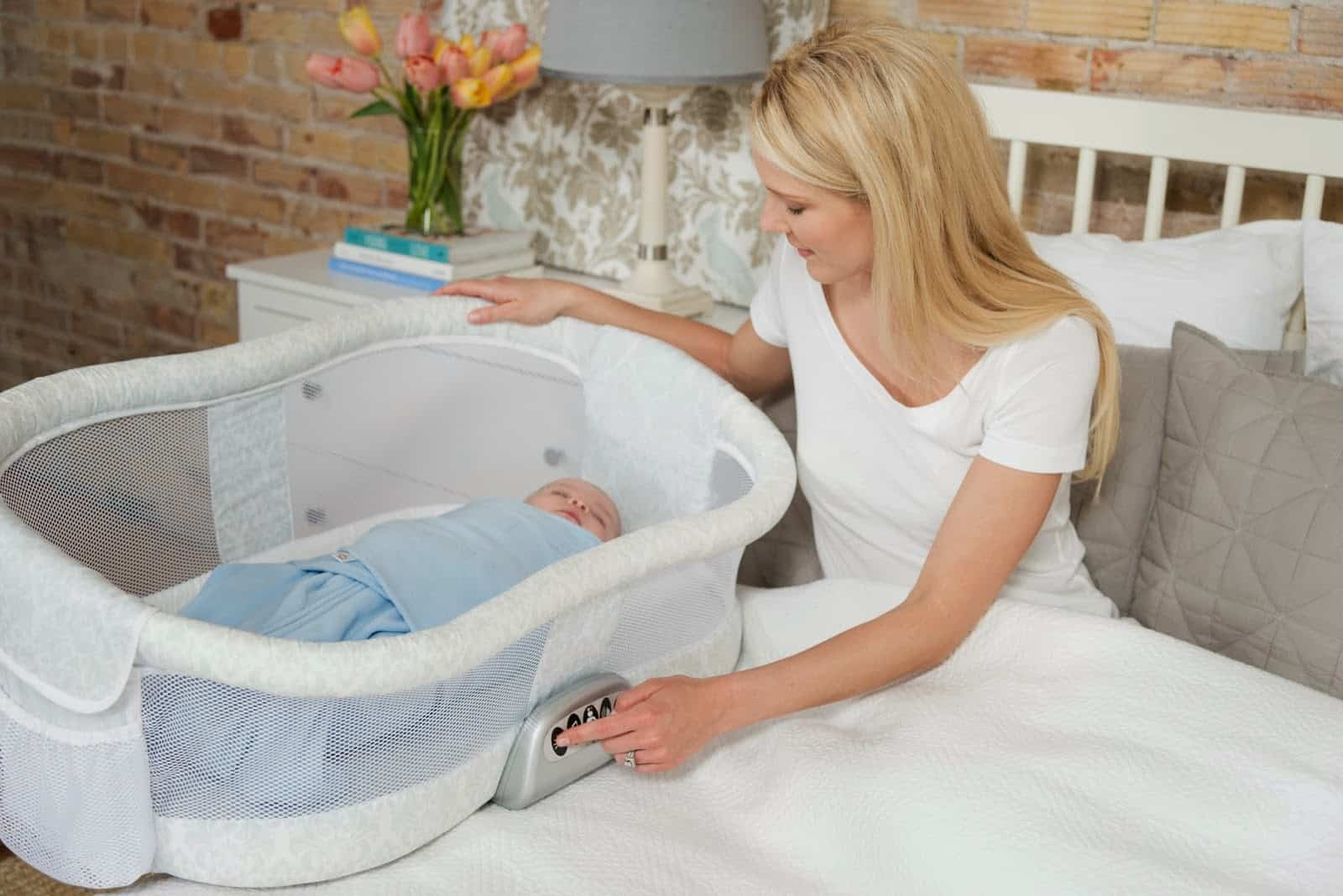 baby in a bassinet with mother