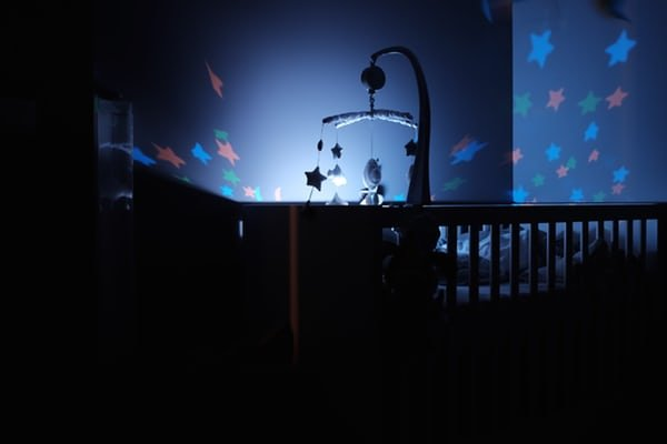 baby crib with toys at night